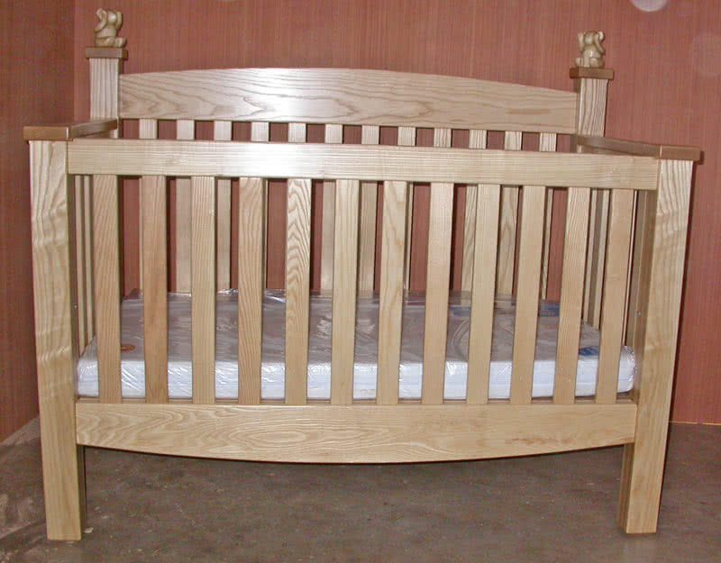 Level view of front profile of bespoke baby cot