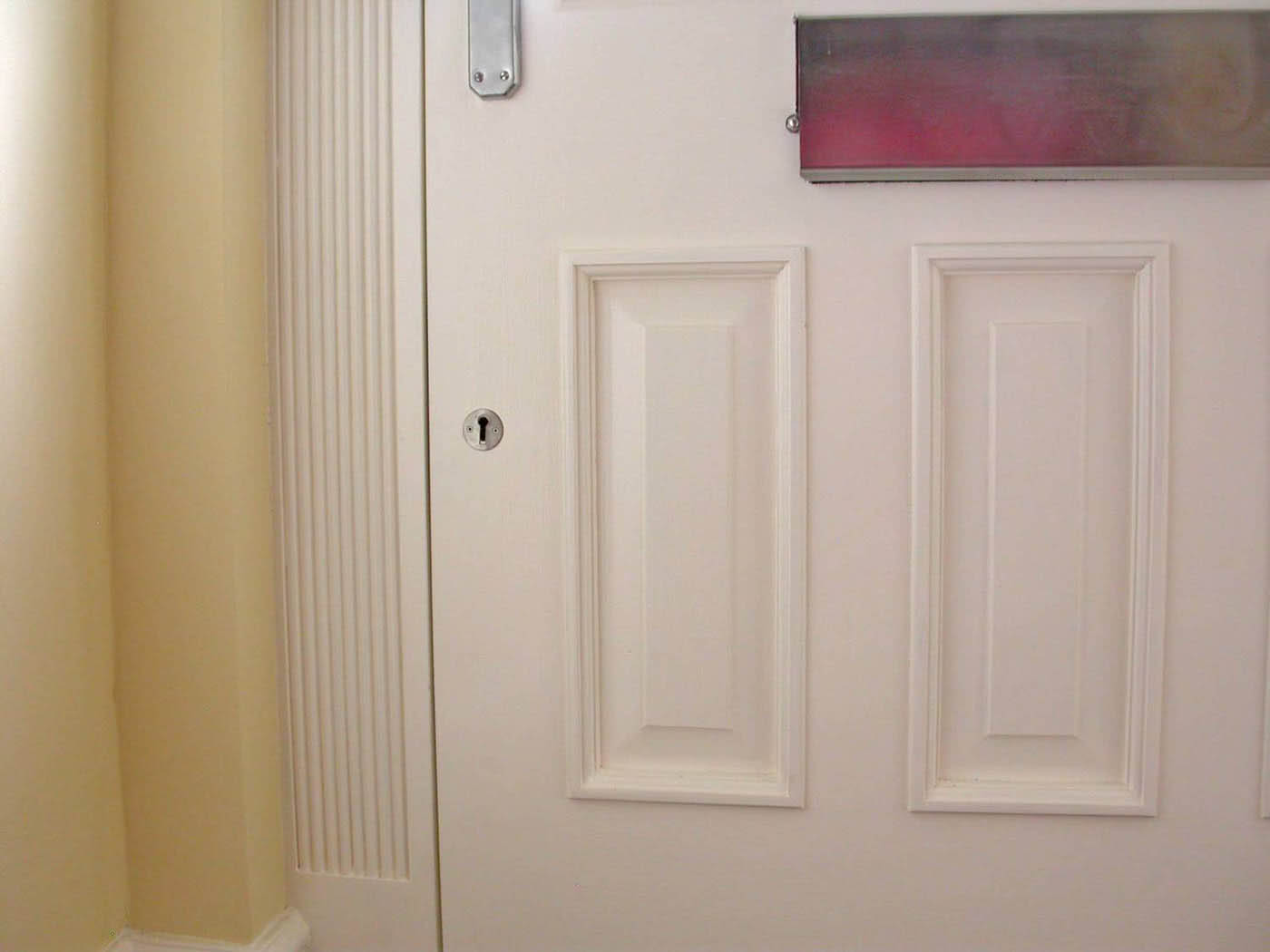 Interior view of two raised panels to a handmade meranti hardwood door and one of two mortice locks