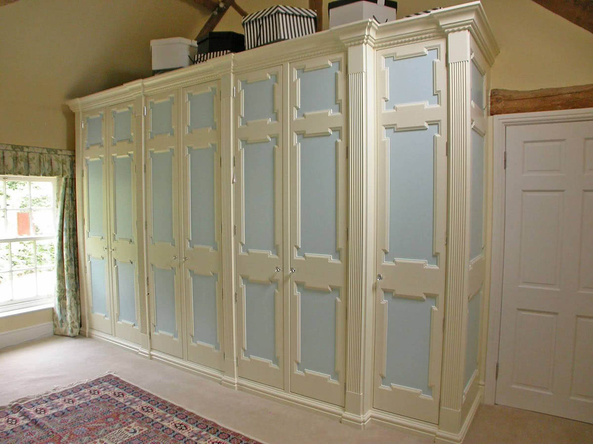 Large fitted country style wardrobes with doors closed