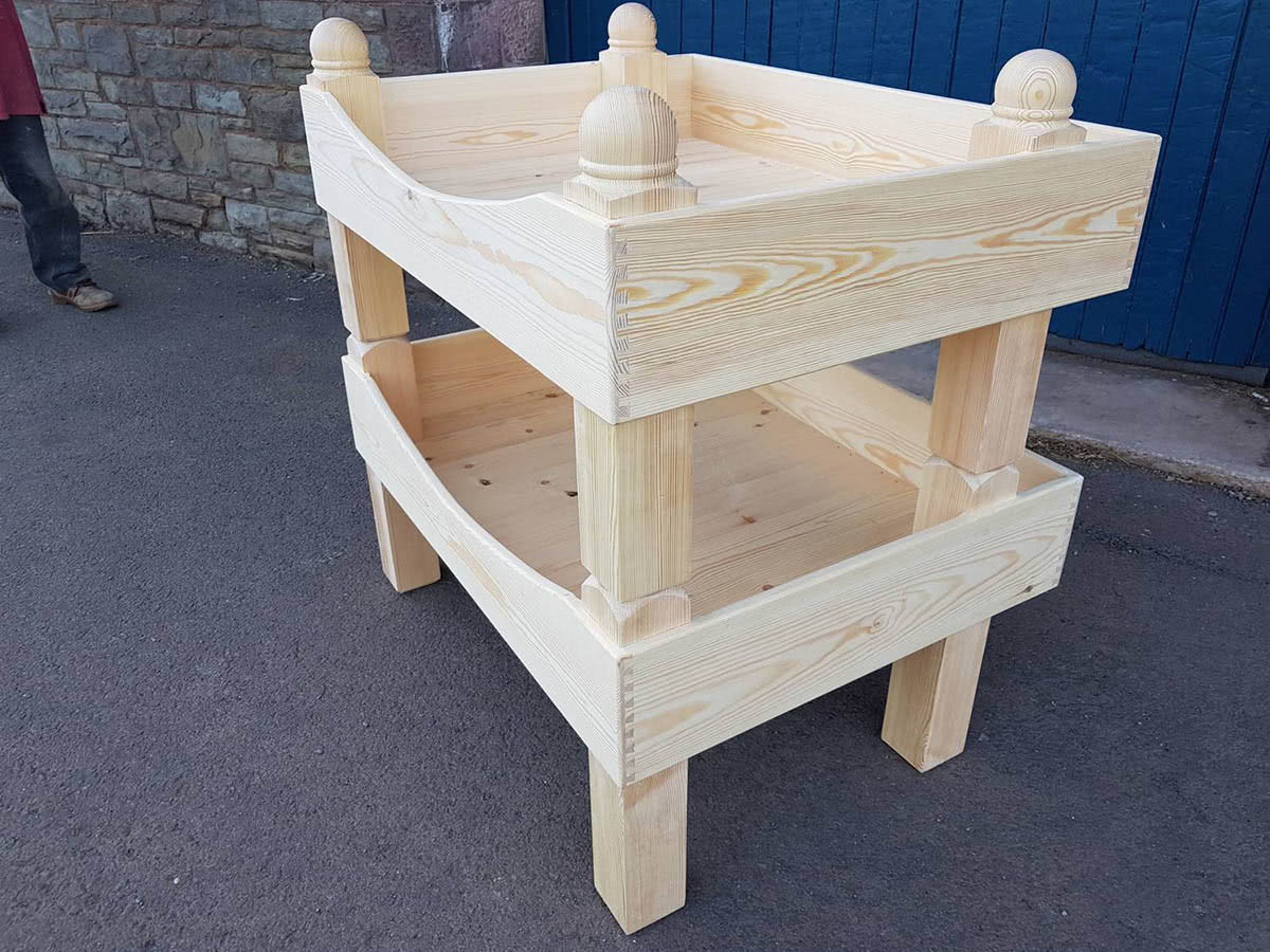 Bespoke dog bunk beds outside workshop. Top bunk bed posts with sphere finials