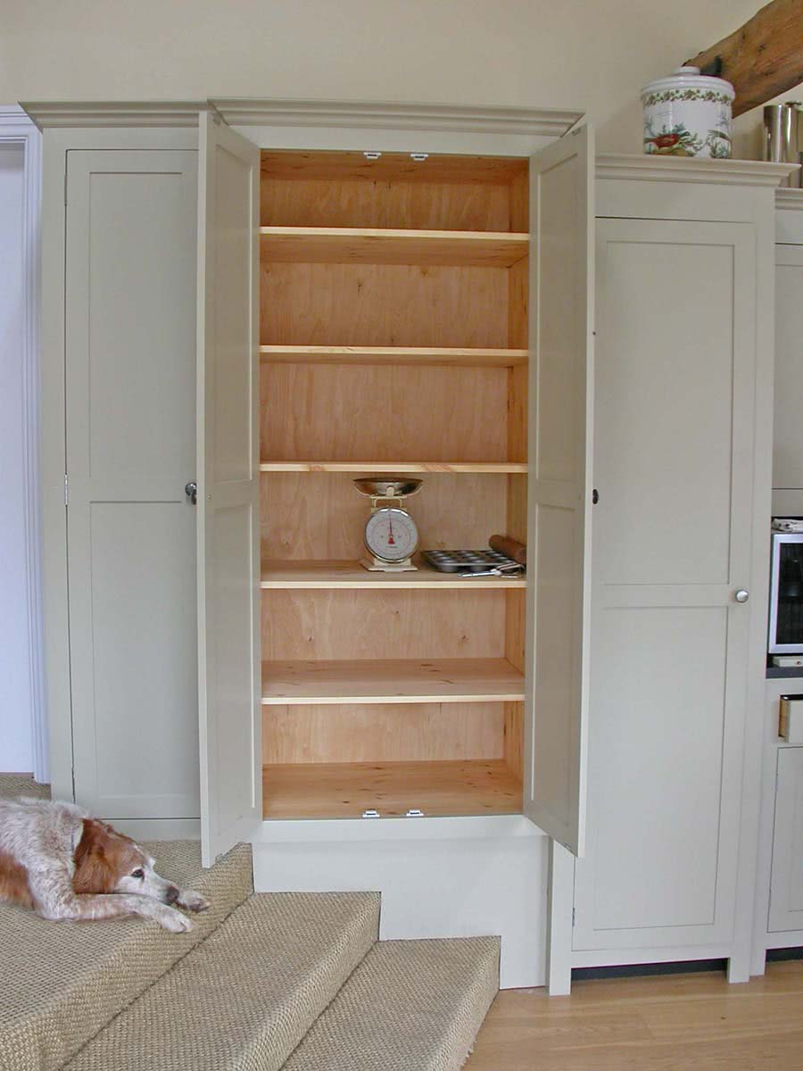 Large handmade double door cabinet open showing shelving space