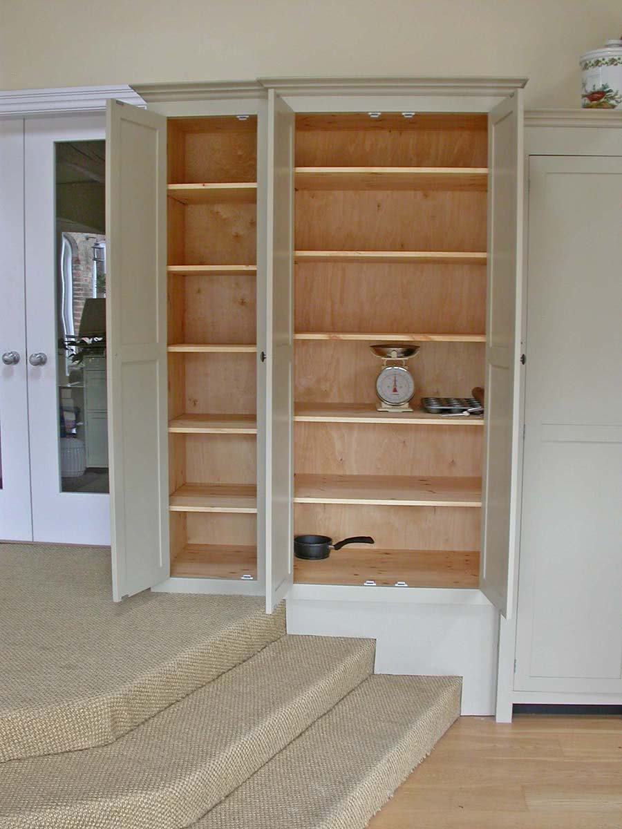 Large handmade double door cabinet and single door cabinet with doors open showing shelving space