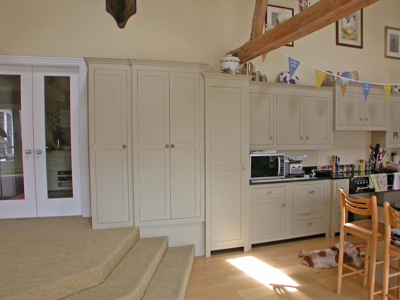 Shot of kitchen cabinets showing new cabinets snuggly fitted to steps