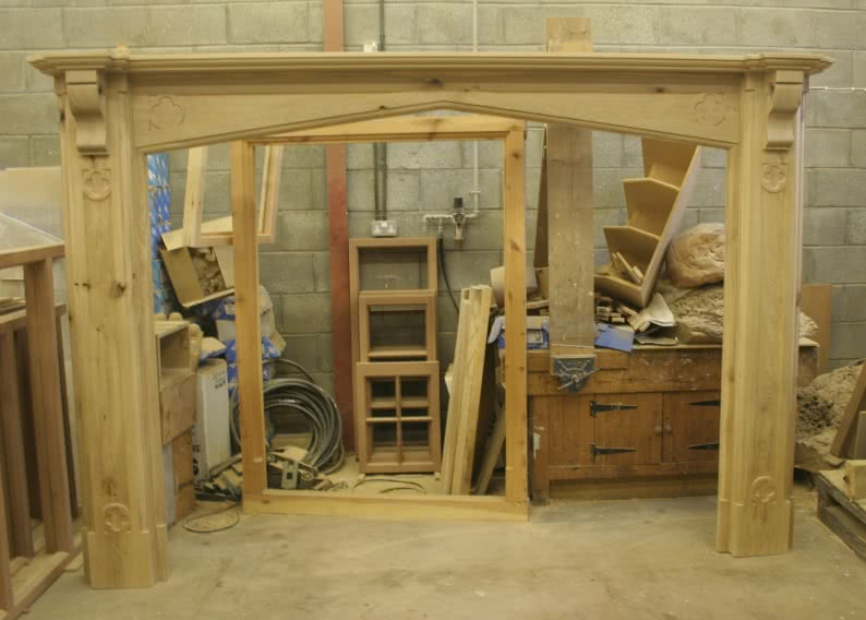 Large oak fireplace in workshop