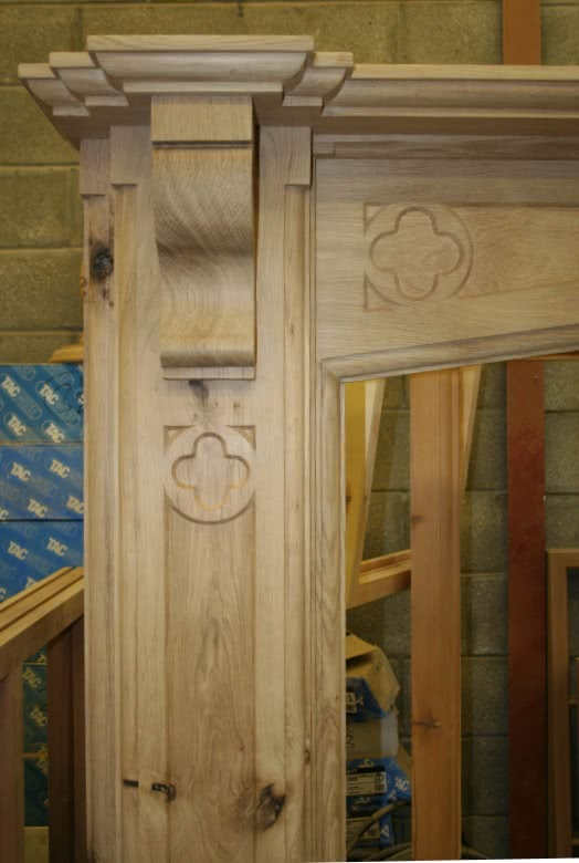 Large oak fireplace in workshop, Left hand side pillar showing cobel and relief quatrefoil carving
