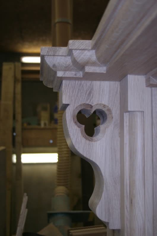 Large oak fireplace in workshop. Close up of left hand side corbel with decorative quatrefoil