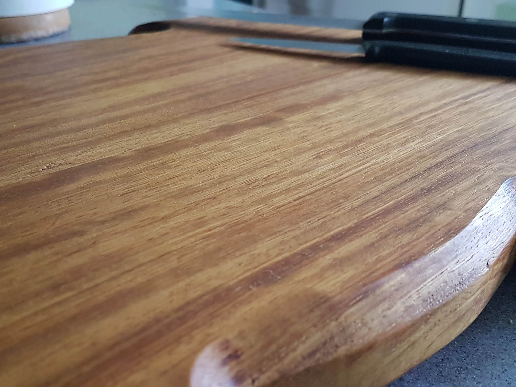 Close up of the Iroko wood grain of pig shaped chopping board