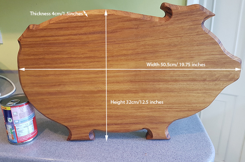 Pig shaped chopping board in Iroko wood with measurements in centimeters