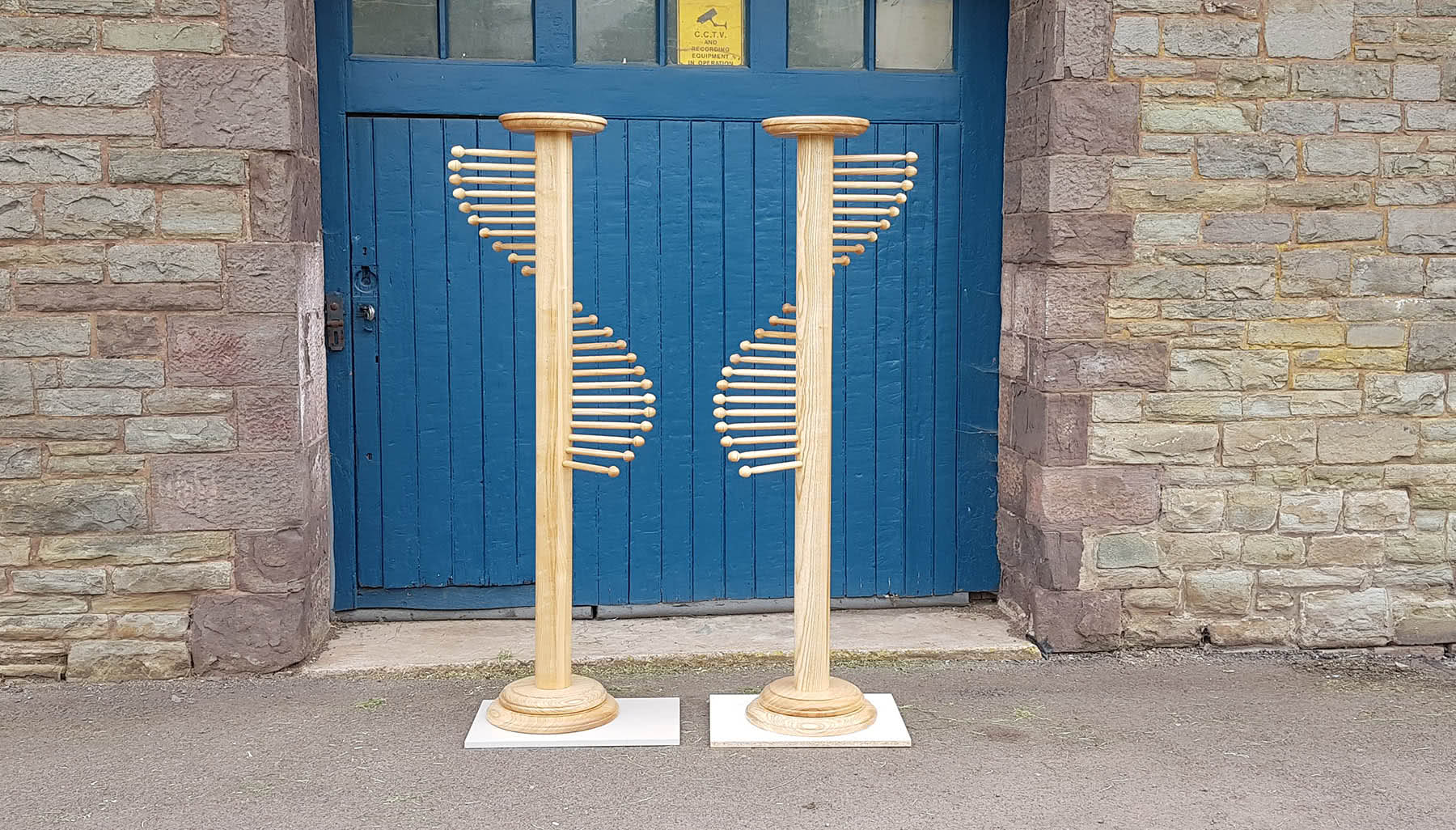 Pair of handmade Scarf Stands outside of workshop